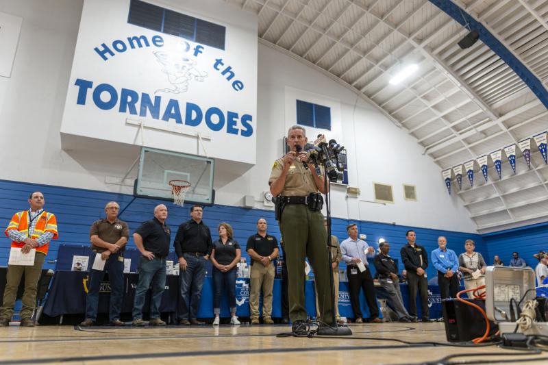 San Bernardino County Sheriff John McMahon speaks to residents and others during a town hall meeting in Trona, Calif., on Wednesday, July 10, 2019. San Bernardino County officials offered updates from several county, state governments and utilities. Aftershocks of last week's big earthquakes are still rumbling beneath the California desert, but seismologists say the probability of large quakes continues to decline. (James Quigg/The Daily Press via AP)