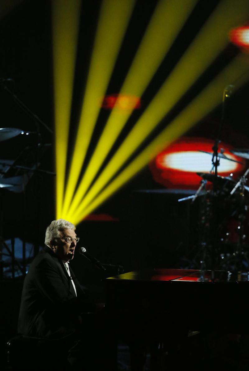 Inductee Randy Newman performs during the Rock and Roll Hall of Fame Induction Ceremony at the Nokia Theatre on Thursday, April 18, 2013 in Los Angeles. Newman is among this year's eight inductees, which also includes rockers Heart and Rush, rap group Public Enemy, disco queen Donna Summer, bluesman Albert King, and producers Quincy Jones and Lou Adler. (Photo by Danny Moloshok/Invision/AP)