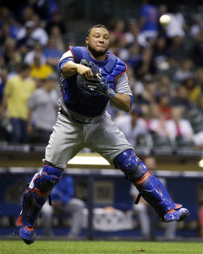 Chicago Cubs catcher Welington Castillo throws to first on a bunt by Milwaukee Brewers' Logan Schafer during the seventh inning of a baseball game Wednesday, June 26, 2013, in Milwaukee. Schafer was out at first. (AP Photo/Morry Gash)