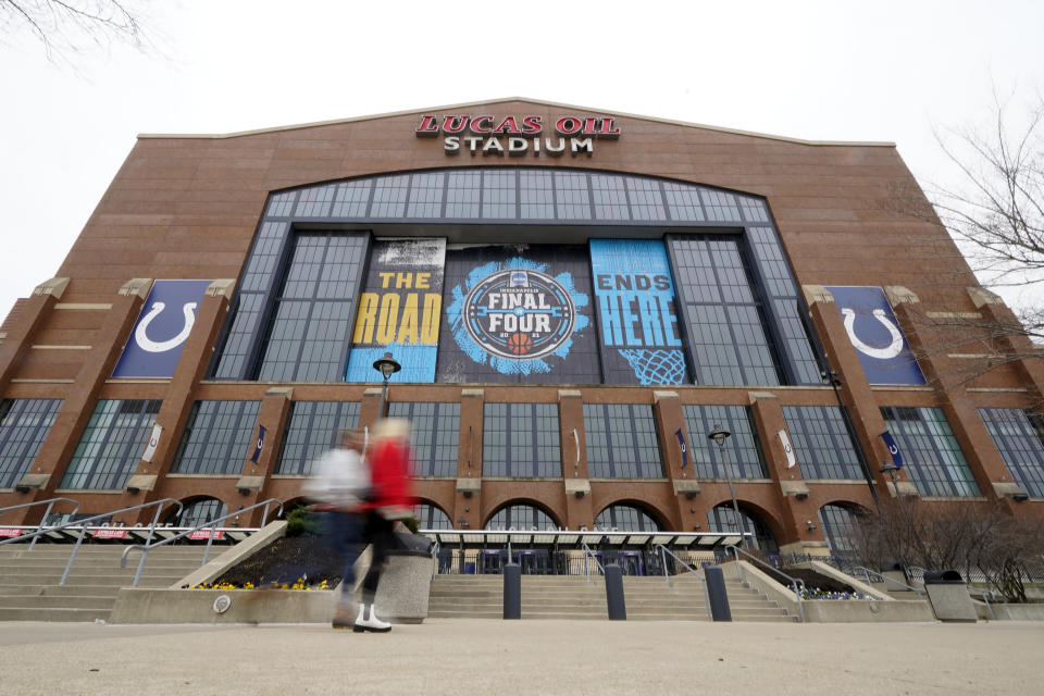 Fan arrives for an NCAA college basketball championship game between Illinois and Ohio State at the Big Ten Conference tournament, Sunday, March 14, 2021, in Indianapolis. (AP Photo/Darron Cummings)