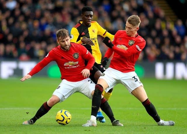 Luke Shaw (left) and Scott McTominay (right) in action for Manchester United