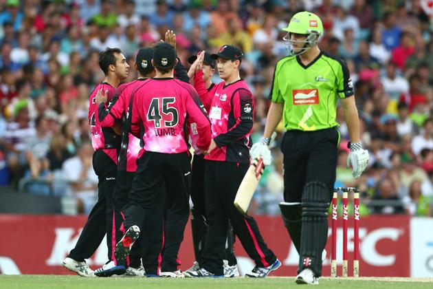 Josh Lalor of the Sixers celebrates with his team after taking the wicket of Sean Abbott of the Thunder during the Big Bash League match between Sydney Thunder and the Sydney Sixers at ANZ Stadium on December 30, 2012 in Sydney, Australia.  (Photo by Mark Kolbe/Getty Images)