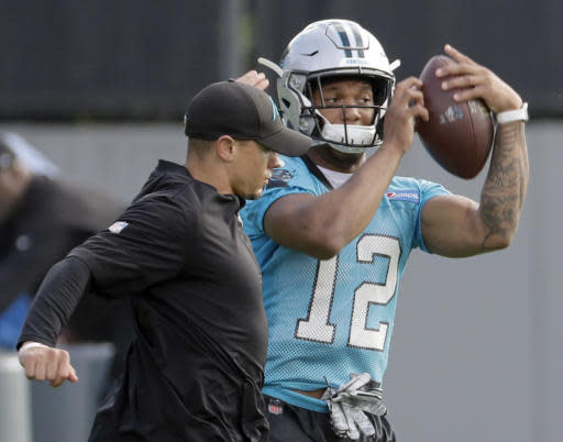 Carolina Panthers' D.J. Moore (12) catches a pass during practice at the NFL football team's facility in Charlotte, N.C., Tuesday, May 22, 2018. While NFL owners are voting to approve the new Panthers owner in Atlanta, the team David Tepper is about to officially own takes to the field for the OTAs back in Charlotte with plenty of new faces. (AP Photo/Chuck Burton)