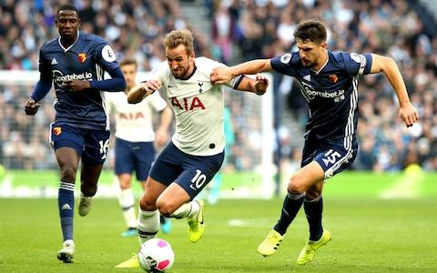 Tottenham Hotspur's Harry Kane (left) and Watford's Craig Cathcart (right) battle for the ball during the Premier League match at Tottenham Hotspur Stadium, London - Credit: PA