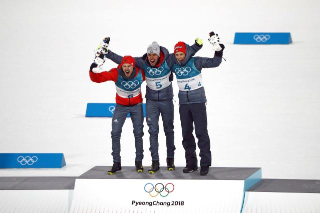 Nordic Combined Events - Pyeongchang 2018 Winter Olympics - Men's Individual 10 km Final - Alpensia Cross-Country Skiing Centre - Pyeongchang, South Korea - February 20, 2018 - Gold medalist Johannes Rydzek of Germany, silver medalist Fabian Riessle of Germany and bronze medalist Eric Frenzel of Germany celebrate during the victory ceremony. REUTERS/Dominic Ebenbichler