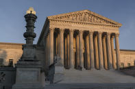 FILE - In this Friday, Nov. 6, 2020 file photo, The Supreme Court is seen at sundown in Washington. The Supreme Court is telling California it can't enforce a ban on indoor church services because of the coronavirus pandemic. The high court issued orders late Friday, Feb. 5, 2021 in two cases where churches had sued over coronavirus-related restrictions in the state. (AP Photo/J. Scott Applewhite, File)