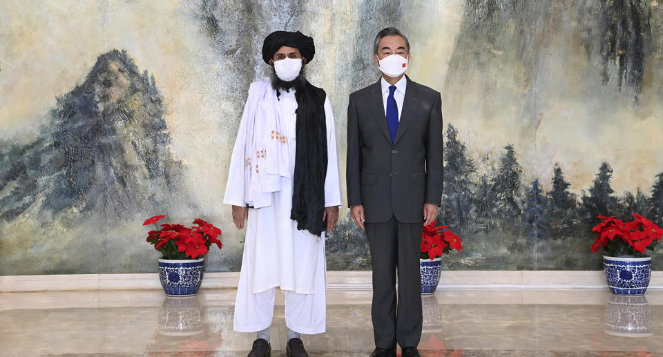 Pictured are Taliban co-founder Mullah Abdul Ghani Baradar and Chinese Foreign Minister Wang Yi.