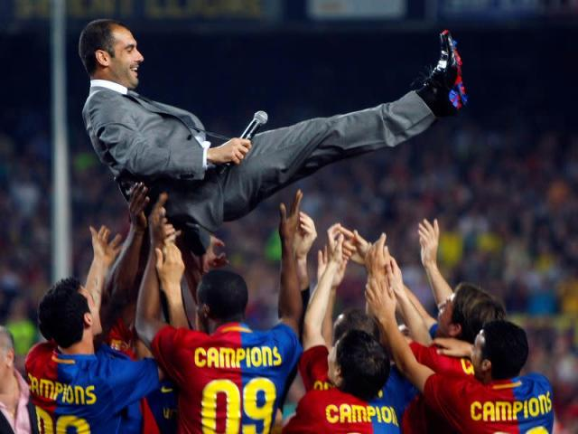 FILE PHOTO: Barcelona coach Pep Guardiola is tossed by players during celebrations of the Spanish La Liga title triumph at Camp Nou stadium.