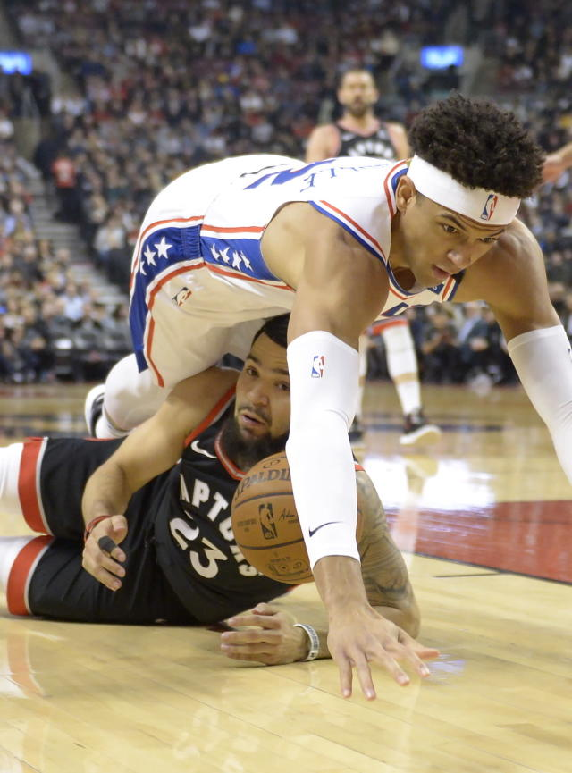 Philadelphia 76ers guard Matisse Thybulle (22) and Toronto Raptors guard Fred VanVleet (23) battle for the loose ball during the first half of an NBA basketball game, Wednesday, Jan. 22, 2020 in Toronto. (Nathan Denette/The Canadian Press via AP)