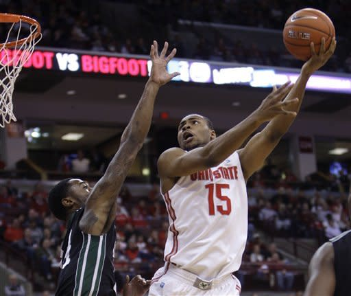 Ohio State's J.D. Weatherspoon, right, shoots over South Carolina Upstate's Jodd Maxey during the first half of an NCAA college basketball game Wednesday, Dec. 14, 2011, in Columbus, Ohio. (AP Photo/Jay LaPrete)