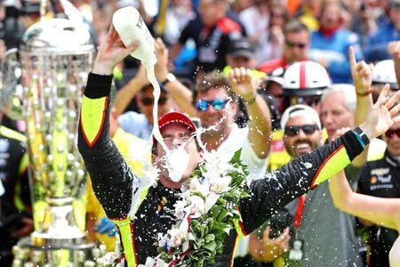 May 26, 2019; Indianapolis, IN, USA; Indycar driver Simon Pagenaud (22) celebrates winning the 103rd Running of the Indianapolis 500 at Indianapolis Motor Speedway. Mandatory Credit: Mark J. Rebilas-USA TODAY Sports