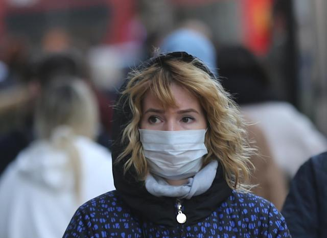 A woman wears a mask as a precaution against coronavirus in London (Ilyas Tayfun Salci/Anadolu Agency via Getty Images)