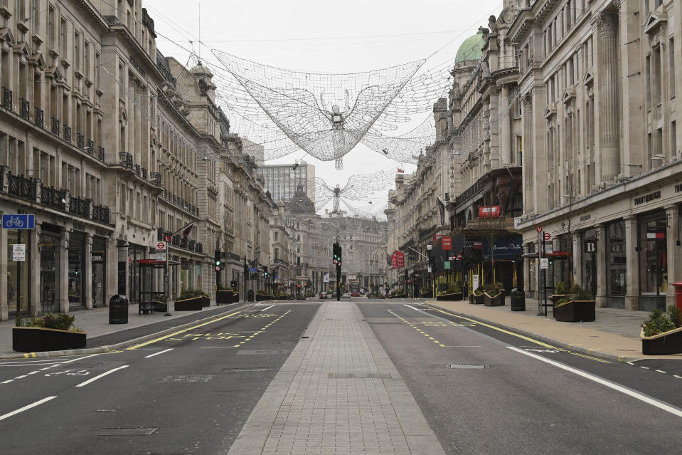 A view of an empty Regent Street, during what would normally be the Boxing Day sales. Boxing Day spending is expected to fall by more than a quarter compared with a year ago, after extensive new COVID-19 restrictions forced non-essential retailers to close, in London, Saturday, Dec. 26, 2020. (Stefan Rousseau/PA via AP)