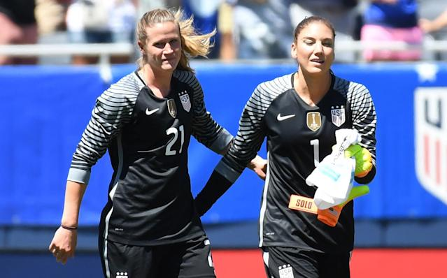 Alyssa Naeher (left) does not share Hope Solo's personality. She wants, however, to share her status as the starting goalkeeper on a World Cup champion. (Getty)