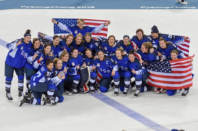 PYEONGCHANG, South Korea – FEBRUARY 22: The U.S. women's hockey team sits for a team photo following the women's gold medal hockey game with the U.S.A. defeating Canada 3-2 in a shootout during the 2018 Winter Olympic Games. (Getty Images)
