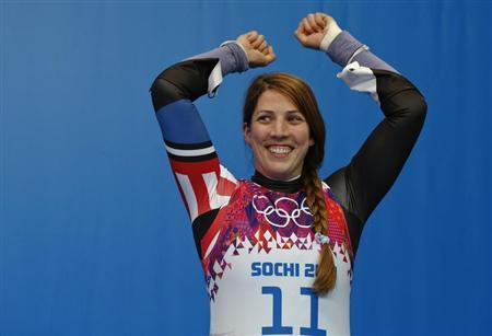 Third-placed Erin Hamlin of the U.S. celebrates after the women's singles luge event at the 2014 Sochi Winter Olympics