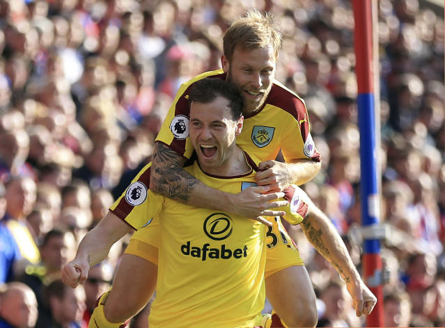 <p>Burnley's Ashley Barnes, foreground, celebrates scoring his side's first goal with teammate Scott Arfield during the English Premier League soccer match between Crystal Palace and Burnley, at Selhurst Park, in London, Saturday April 29, 2017. (Nigel French/PA via AP) </p>