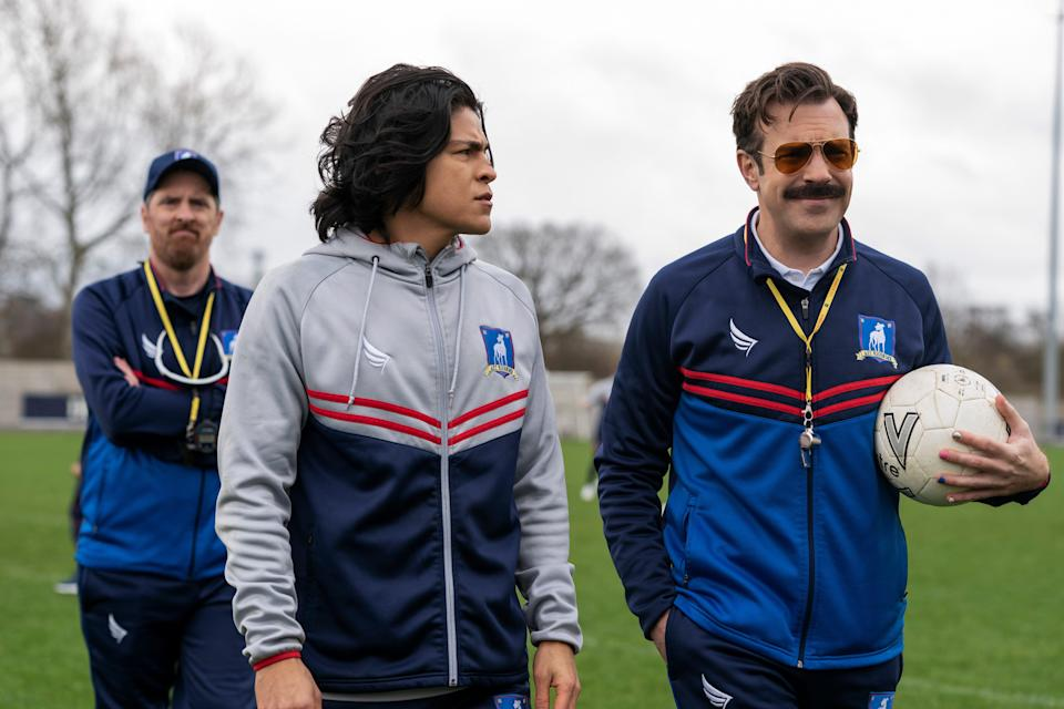 """Among the stars of the Emmy-winning Apple TV+ series """"Ted Lasso"""" are Brendan Hunt (left) as Coach Beard, Cristo Fernández as AFC Richmond player Danny Rojas and Jason Sudeikis as coach Ted Lasso."""