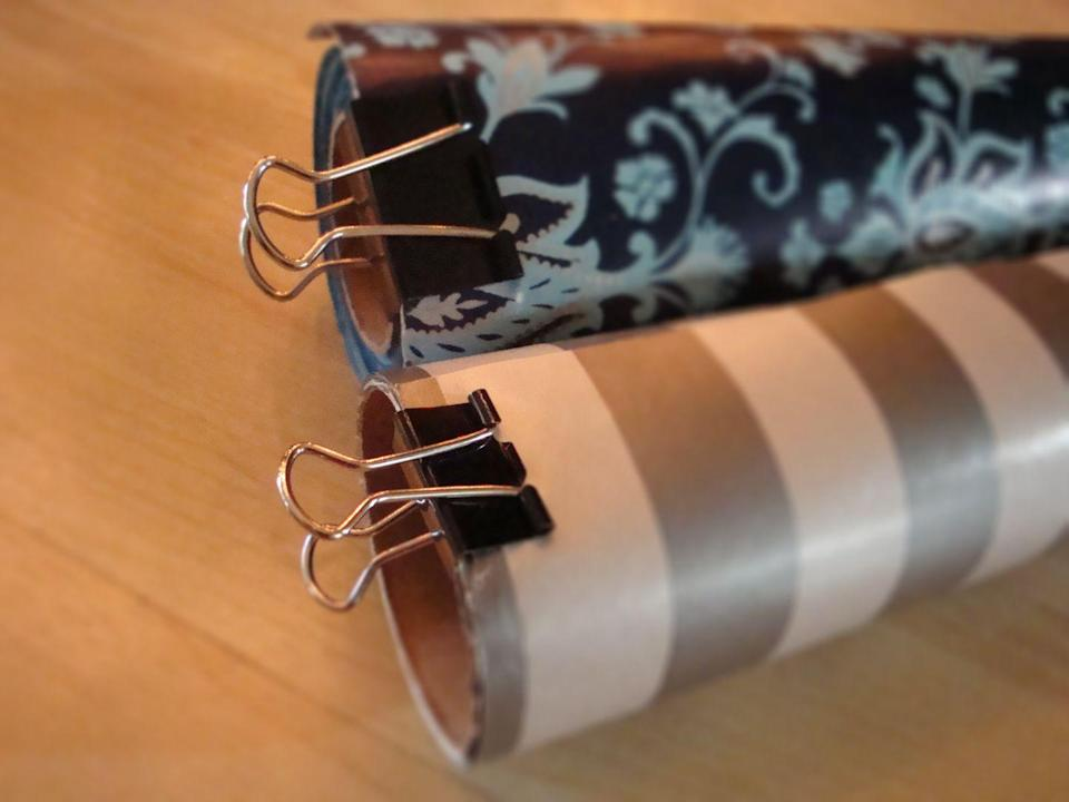 """<p>Rolls of wrapping paper stay as neat as the day you bought them when smartly clipped.</p><p><a href=""""http://getsimplifized.com/30-uses-for-binder-clips-theyre-not-just-for-the-office-anymore"""" rel=""""nofollow noopener"""" target=""""_blank"""" data-ylk=""""slk:See more at Get Simplifized »"""" class=""""link rapid-noclick-resp""""><em>See more at Get Simplifized »</em></a></p>"""