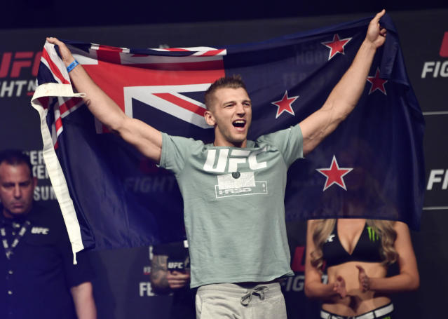Dan Hooker of New Zealand prepares to step on the scale during the UFC weigh-in at Spark Arena on Feb. 22, 2020, in Auckland, New Zealand. (Photo by Jeff Bottari/Zuffa LLC via Getty Images)