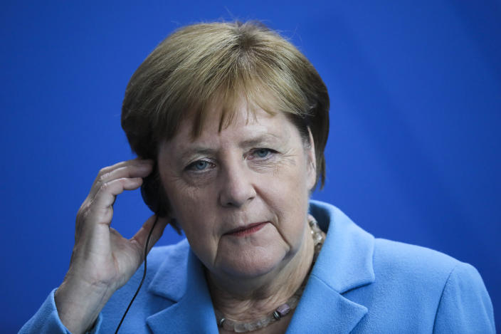 German Chancellor Angela Merkel listens to questions during a news conference following a meeting with the Prime Minister of Finland Antti Rinne at the chancellery in Berlin, Wednesday, July 10, 2019. (AP Photo/Markus Schreiber)