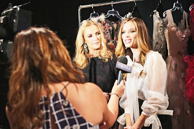 Keren Craig and Chapman, right, are interviewed backstage at the Marchesa fashion show last year during New York Fashion Week. (Photo: Getty Images)