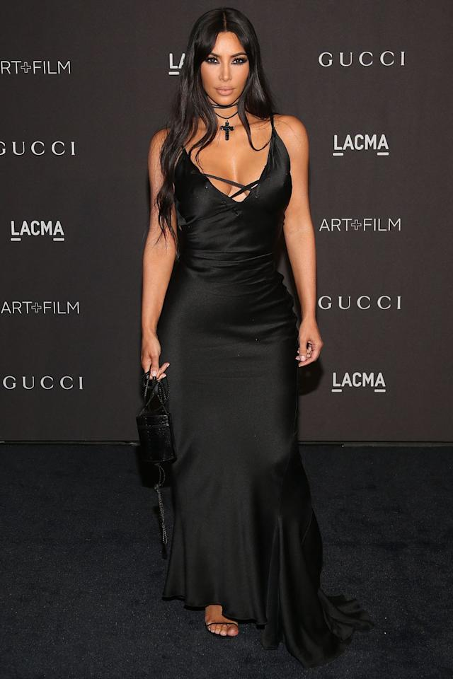 <p>In a Tom Ford for Gucci silk gown, black sandals, mini purse, and layered cross choker for the LACMA Art+Film Gala in Los Angeles. </p>