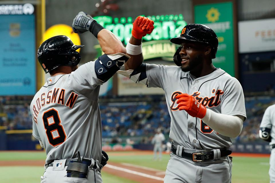 Detroit Tigers' Akil Baddoo, right, celebrates his home run with teammate Robbie Grossman during the first inning of a baseball game against the Tampa Bay Rays, Friday, Sept. 17, 2021, in St. Petersburg, Fla.
