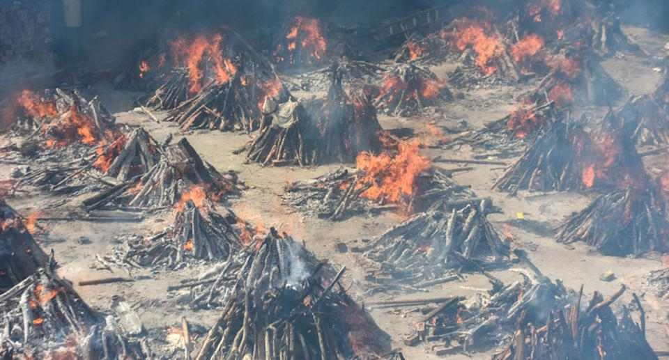 Multiple funeral pyres of people who died of Covid-19 burning simultaneously at Gazipur crematorium on April 24, 2021 in New Delhi, India.