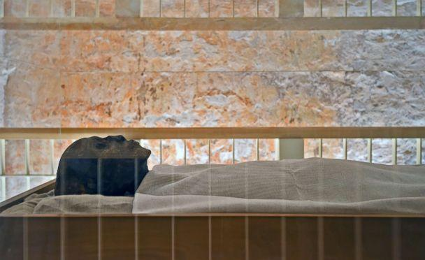 PHOTO: The linen-wrapped mummy of of the 18th dynasty Pharaoh Tutankhamun displayed in his climate controlled glass case in his underground tomb in the Valley of the Kings on the west bank of the Nile river opposite the southern Egyptian city of Luxor. (Mohamed El-Shahed/AFP/Getty Images)