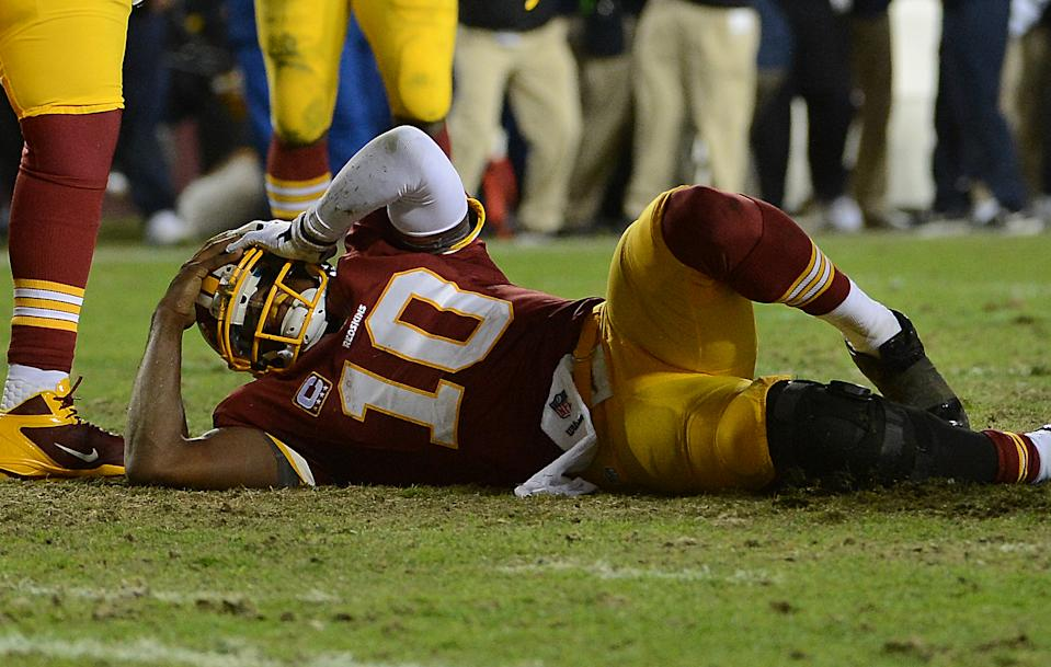 LANDOVER, MD - JANUARY 06: Washington Redskins quarterback Robert Griffin III (10) stays on the ground after injuring his knee in the fourth quarter of the first round NFC playoff game between the Washington Redskins and the Seattle Seahawks at FedEd Field in Landover, Md., on Sunday, January 6, 2013. (Photo by Toni L. Sandys/The Washington Post via Getty Images)