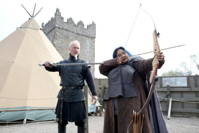 US 'Game of Thrones' fans take part in archery with Master of Arms Will van der Kells (L) at the Castle Ward Estate in Strangford, northern Ireland. Tourists come from around world to the visit the locations of the fantasy TV series