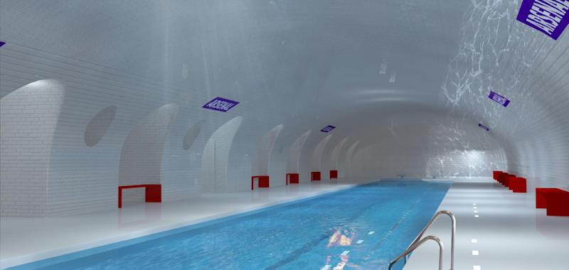 This computer image provided in March 2014 by Laisne Architectes shows an abandoned Paris subway station turned into a swimming pool, part of conservative candidate for Paris Mayor Nathalie Kosciusko-Morizet's, known as NKM, plan to reimagine the city. Paris has 10 abandoned metro stations, mostly unseen as the trains hurtle through their darkened tunnels. NKM has a futuristic plan to transform these stations into public spaces like a swimming pool, performance hall or restaurant. (AP Photo/Oxo Archiract; Nicolas Laisne Architectes)
