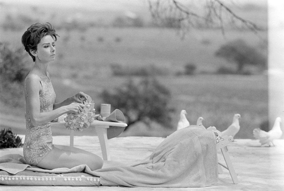 <p>Audrey Hepburn sits by a swimming pool in Saint-Tropez.</p><p>Other celebrity visitors this year: Brigitte Bardot.</p>