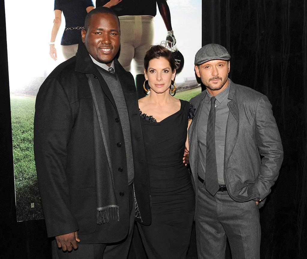 """<a href=""""http://movies.yahoo.com/movie/contributor/1810098051"""">Quinton Aaron</a>, <a href=""""http://movies.yahoo.com/movie/contributor/1800018970"""">Sandra Bullock</a> and <a href=""""http://movies.yahoo.com/movie/contributor/1800227534"""">Tim McGraw</a> at the New York City premiere of <a href=""""http://movies.yahoo.com/movie/1810088176/info"""">The Blind Side</a> - 11/17/2009"""