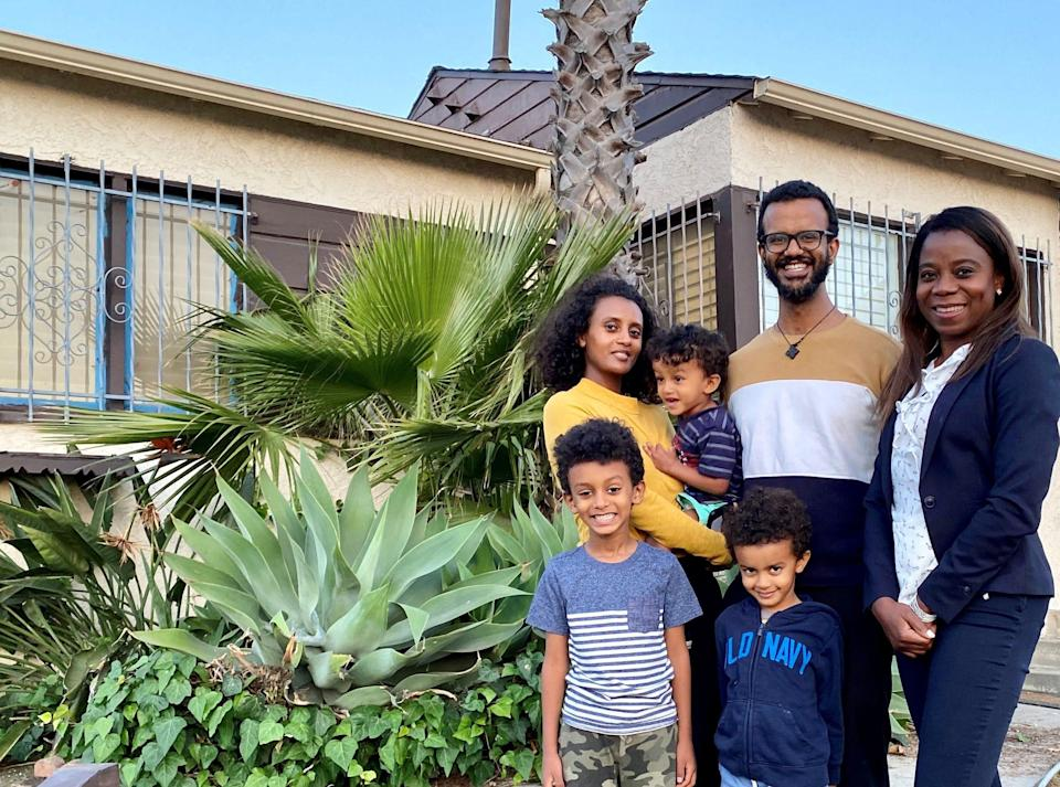 Yoni and Meaza Kebede with their children and their real estate agent Misty Afolabi (right).