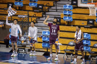Texas Southern players on the bench react as time expires in the team's First Four game against Mount St. Mary's in the NCAA men's college basketball tournament Thursday, March 18, 2021, in Bloomington, Ind. (AP Photo/Doug McSchooler)