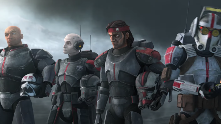 Four members of the Bad Batch stand at attention in their uniforms.
