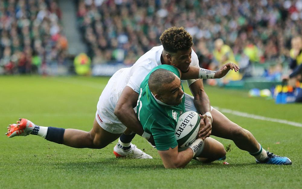 Ireland's Simon Zebo tackled by Anthony Watson - Credit: PA Wire