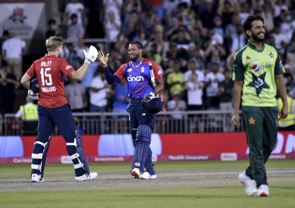 England's David Willey, left, and Chris Jordan celebrate their win in the third Twenty20 international cricket match against Pakistan at Old Trafford in Manchester, Tuesday, July 20, 2021. (AP Photo/Rui Vieira)
