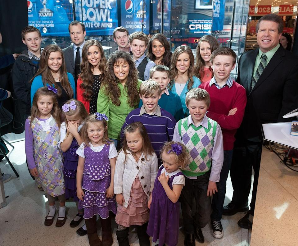 """The Duggar family visits """"Extra' at its New York studios at H&M in Times Square on March 11, 2014, in New York City. (Photo: Getty Images)"""