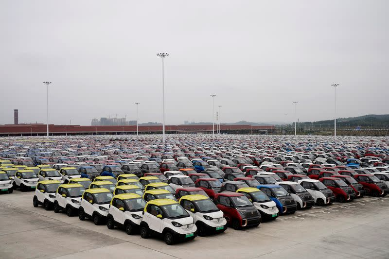 FILE PHOTO: Baojun E100 and E200 all-electric battery cars sit parked at a parking lot operated by General Motors Co and its local joint-venture partners in Liuzho