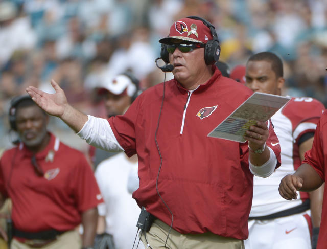 Arizona Cardinals head coach Bruce Arians questions a call by officials during the first half of an NFL football game against the Jacksonville Jaguars in Jacksonville, Fla., Sunday, Nov. 17, 2013. (AP Photo/Phelan M. Ebenhack)