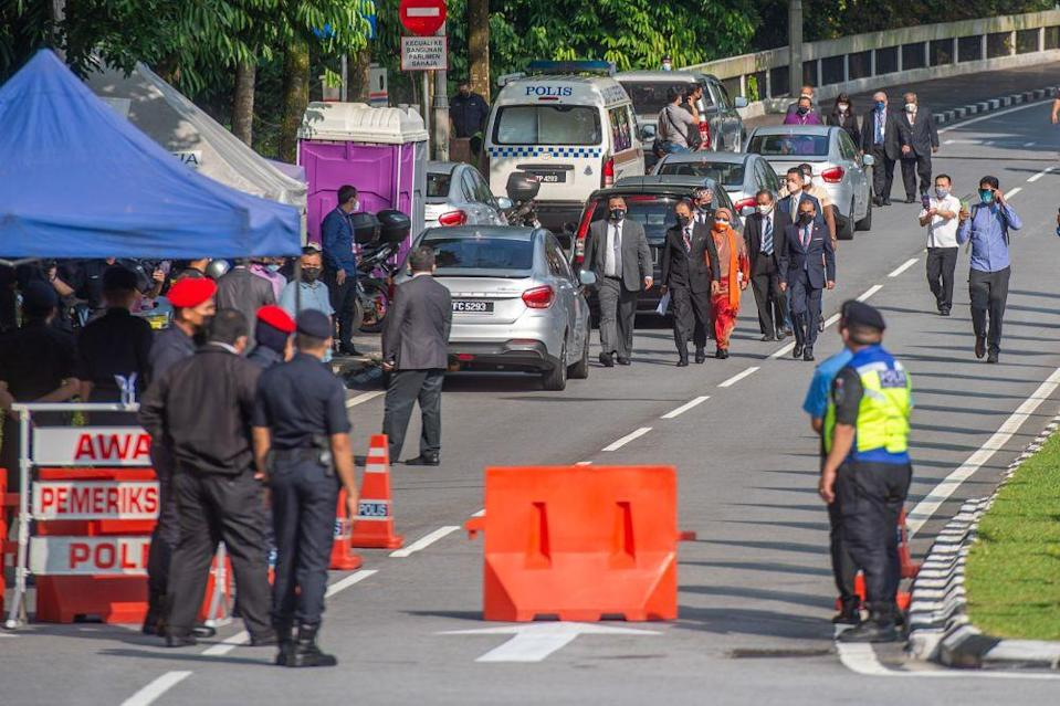 Opposition senators are pictured after marching to the Parliament building to hand a memorandum to Dewan Negara secretary Muhd Sujairi Abdullah on August 3, 2021. ― Picture by Shafwan Zaidon