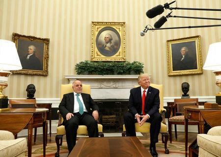 U.S. President Donald Trump meets with Iraqi Prime Minister Haider al-Abadi in the Oval Office at the White House in Washington