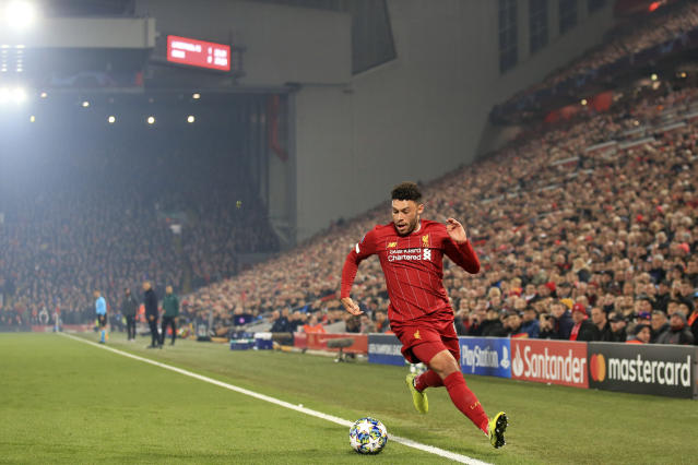 Liverpool's Alex Oxlade-Chamberlain runs with the ball during the Champions League group E soccer match between Liverpool and Genk at Anfield Stadium, Liverpool, England, Tuesday, Nov. 5, 2019. (AP Photo/Jon Super)