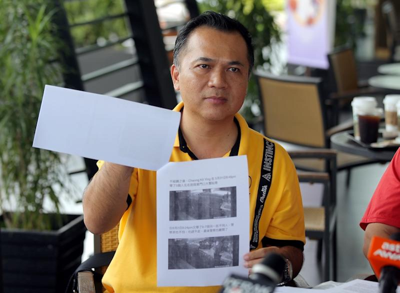 Teng Hwa Lin shows pictures of his friend allegedly making threats and demanding money in front of his house in Tambun August 14, 2019. — Picture by Farhan Najib