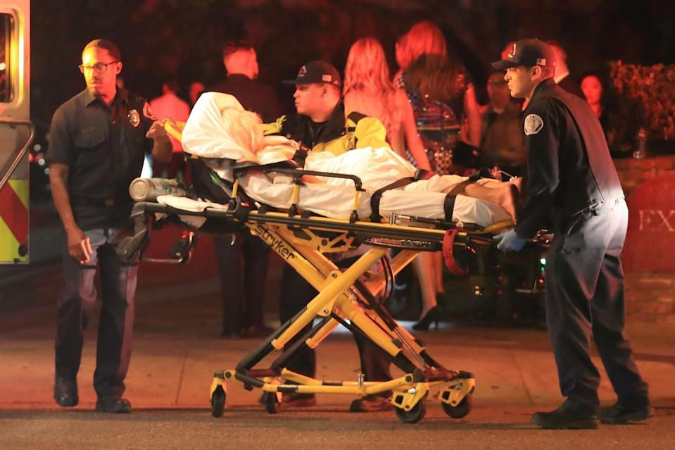 Photos of a blonde, that The Blast reports is Tammy Hembrow, being stretchered away from the party have emerged. Source: Backgrid