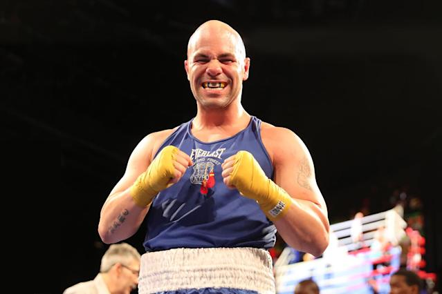"<p>Mark ""Muscle Shark"" Sinatra shows off a mouthpiece smile following his victory in the Super Heavy Champ class of the NYPD Boxing Championships at the Theater at Madison Square Garden on June 8, 2017. (Photo: Gordon Donovan/Yahoo News) </p>"