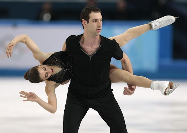 Marissa Castelli and Simon Shnapir of The United States compete in the team pairs short program igure skating competition at the Iceberg Skating Palace during the 2014 Winter Olympics, Thursday, Feb. 6, 2014, in Sochi, Russia. (AP Photo/Ivan Sekretarev)